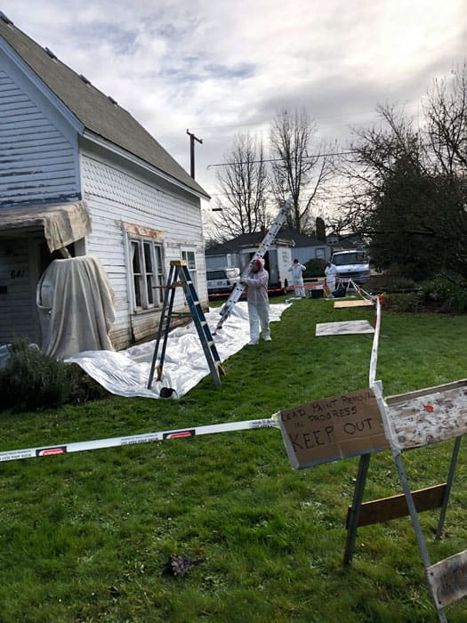 Suiting up for Lead Paint Removal in downtown Corvallis